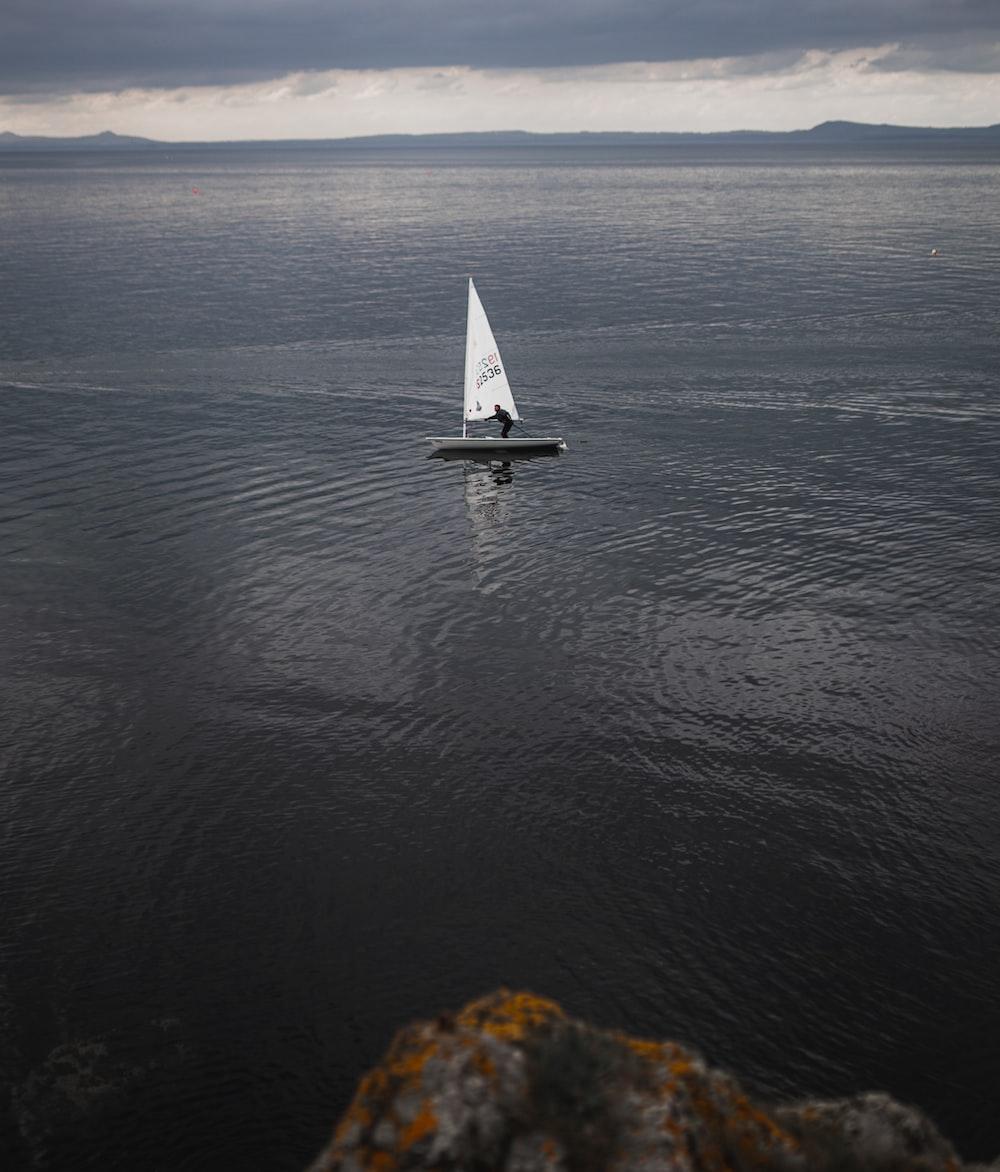 white and grey sailboat