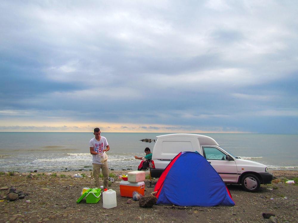 man preparing for the camp near beach