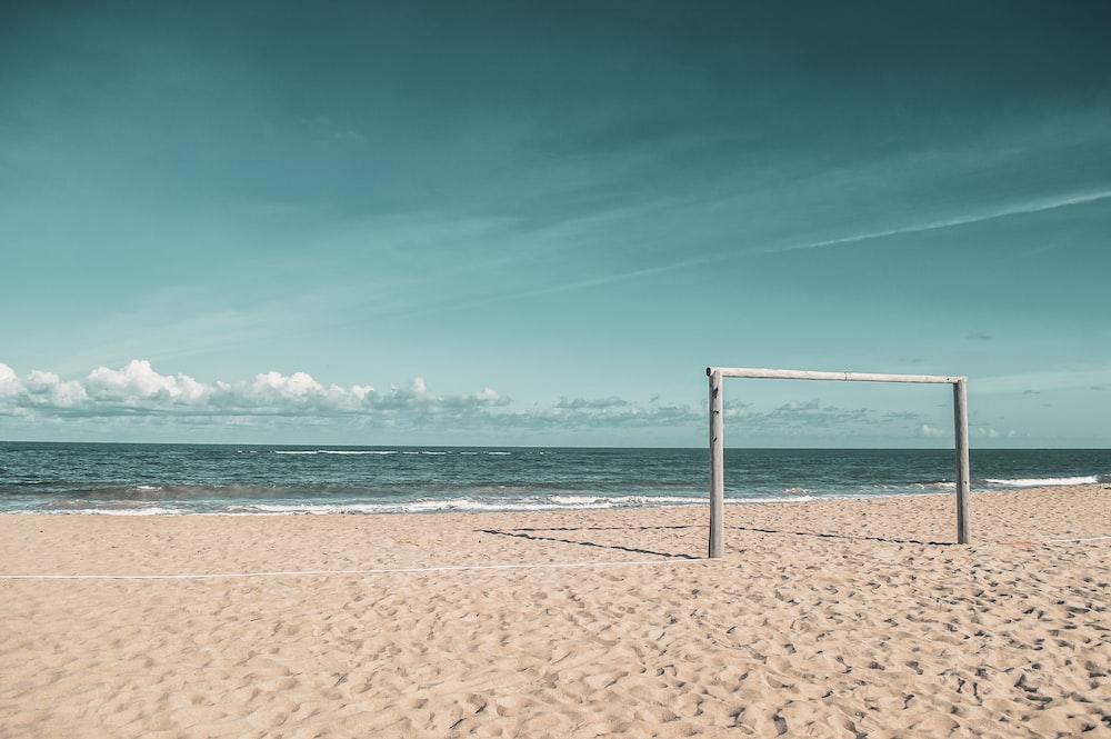 goalie standing at the sand dunes near seashore