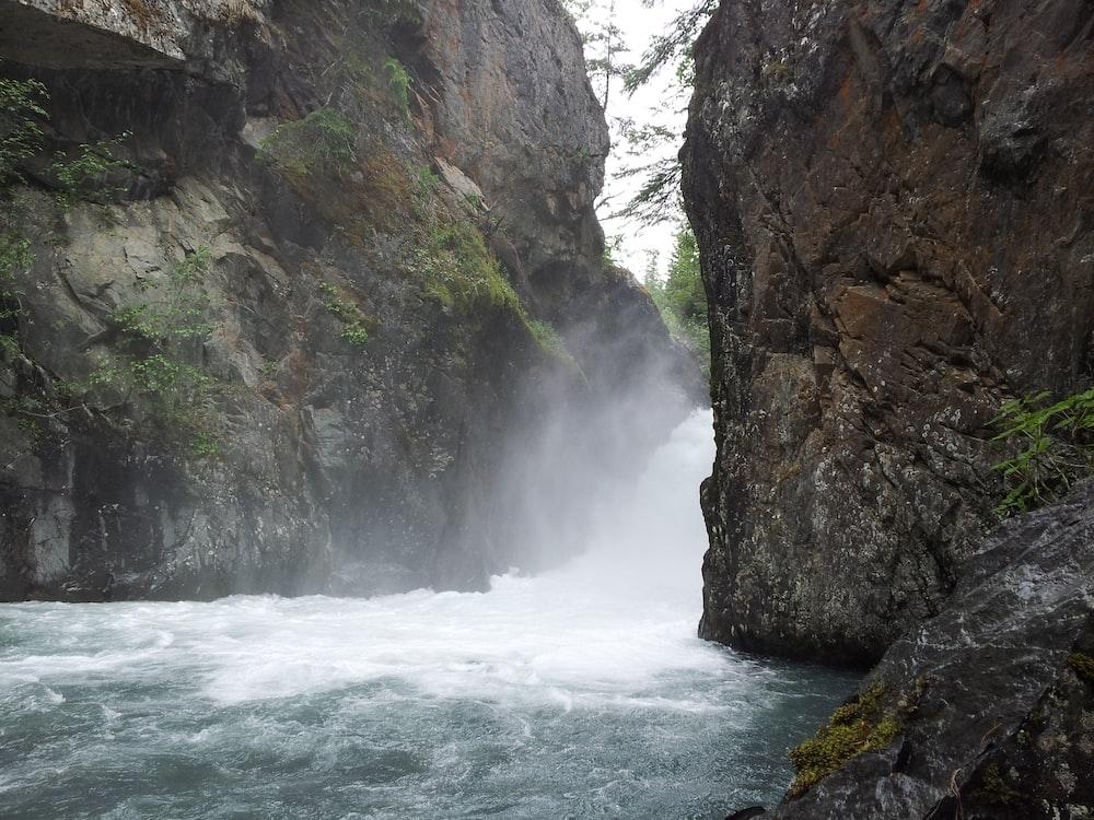 waterfalls between cliffs