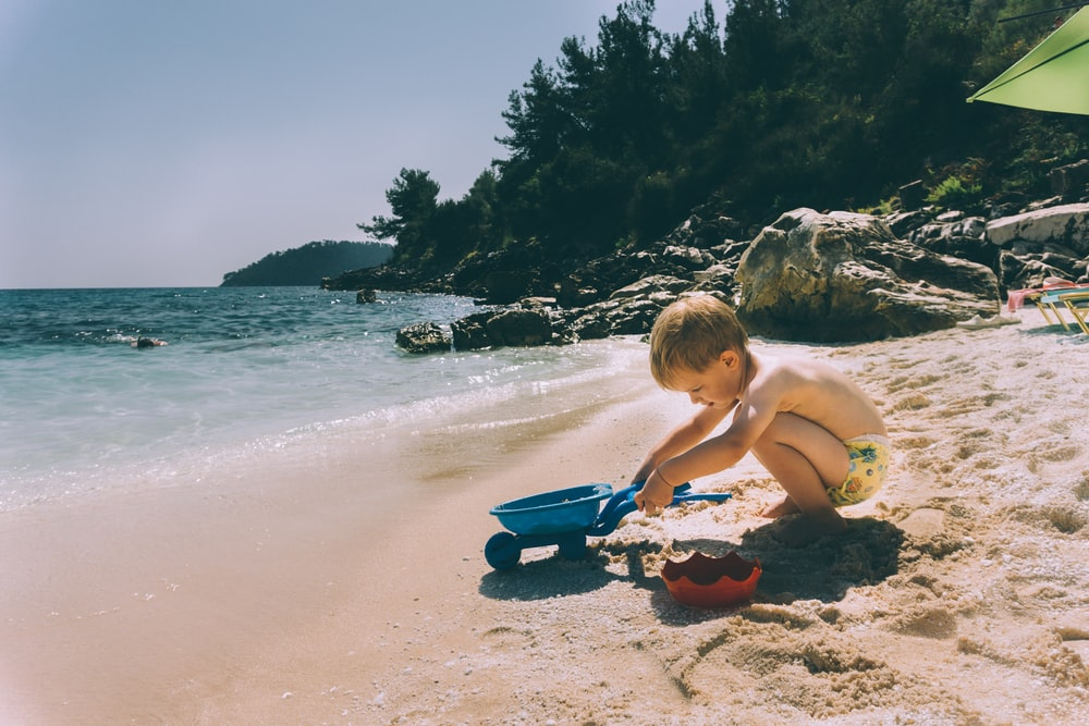 toddler playing at the beach