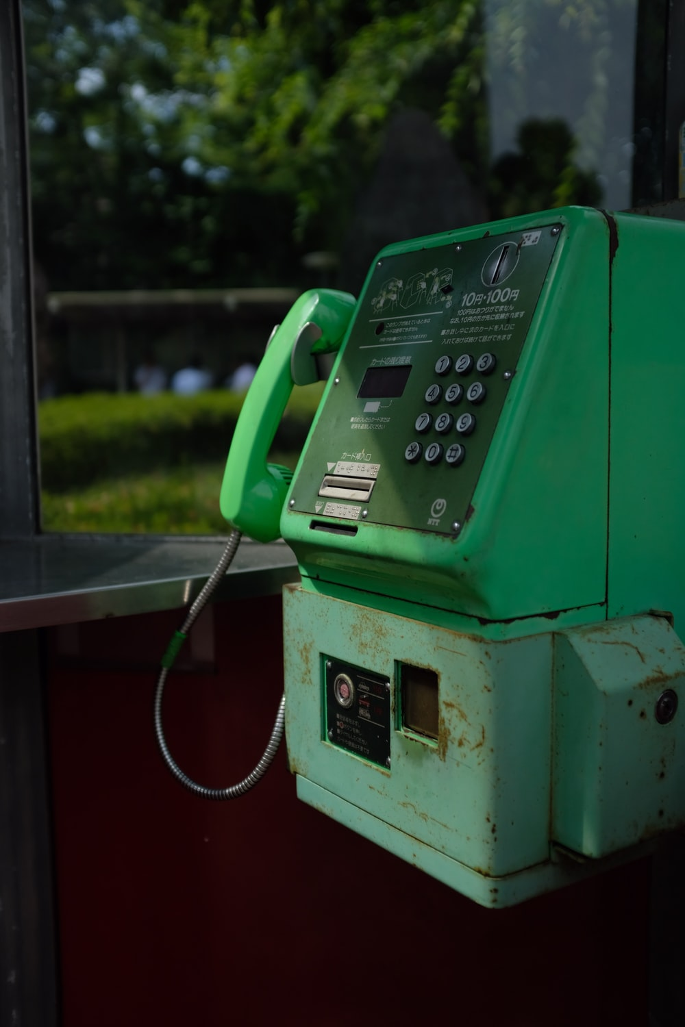 green coin operated telephone