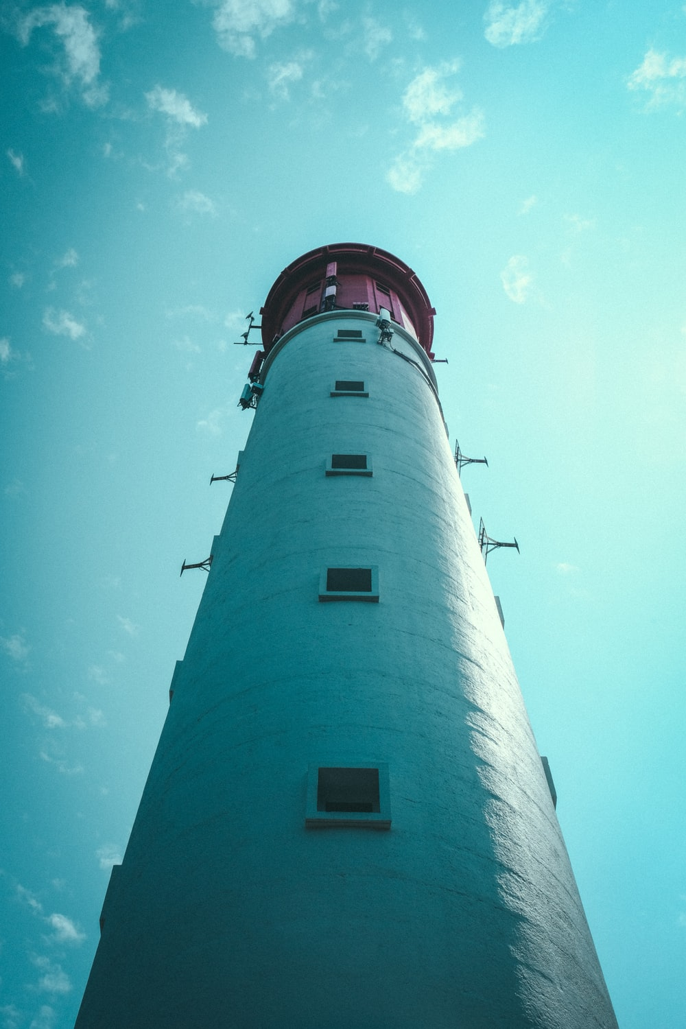 worm's eye view photography of lighthouse