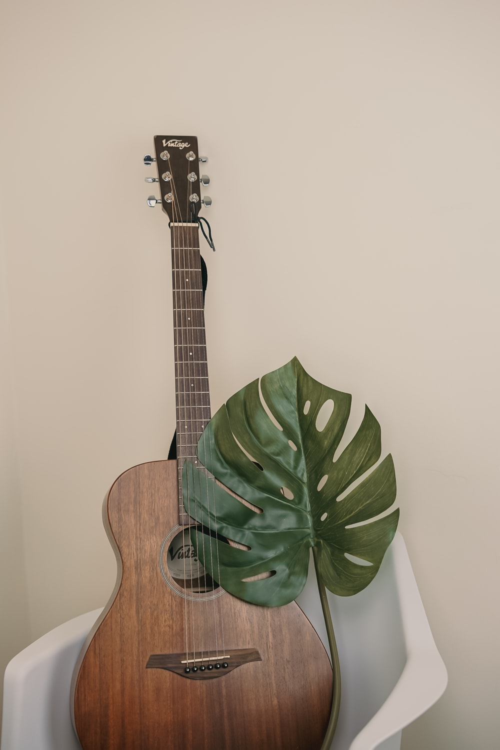 brown guitar on chair