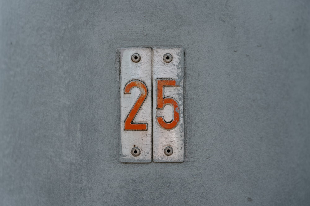 gray metal tool with 25 stickers