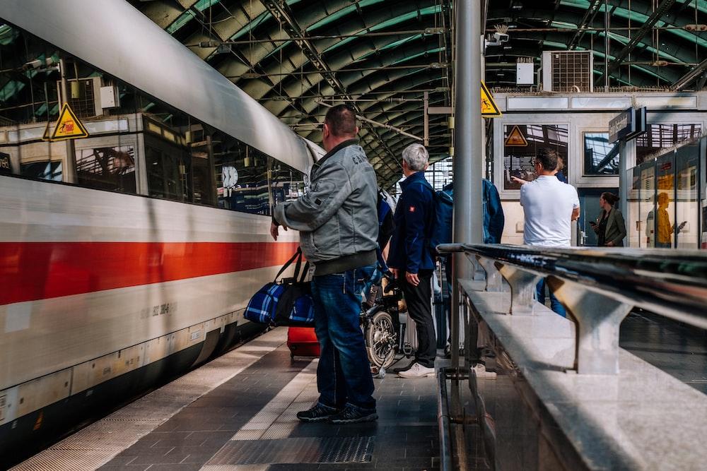 people standing near train