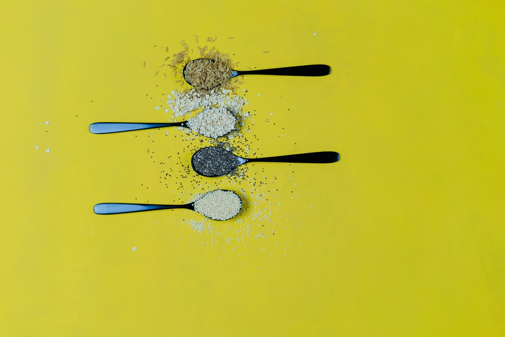 four condiments on spoons
