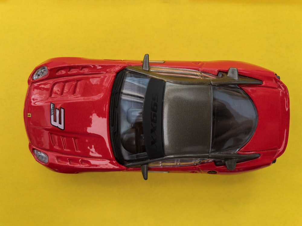 red and black vehicle toy