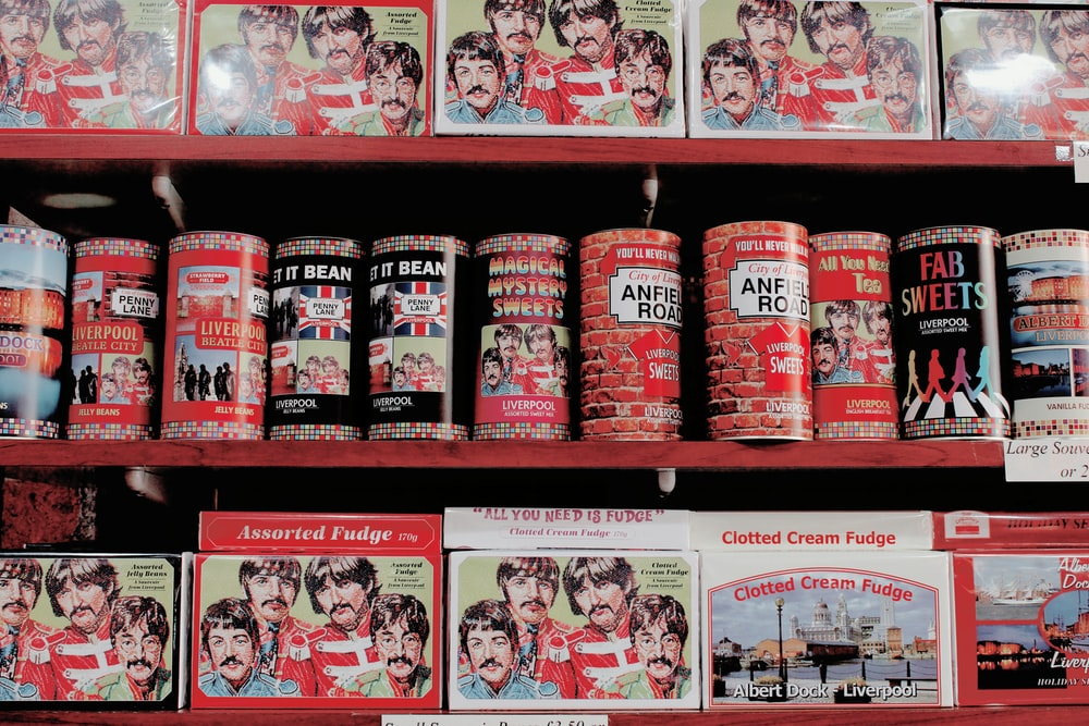 assorted cans and boxes on red shelves