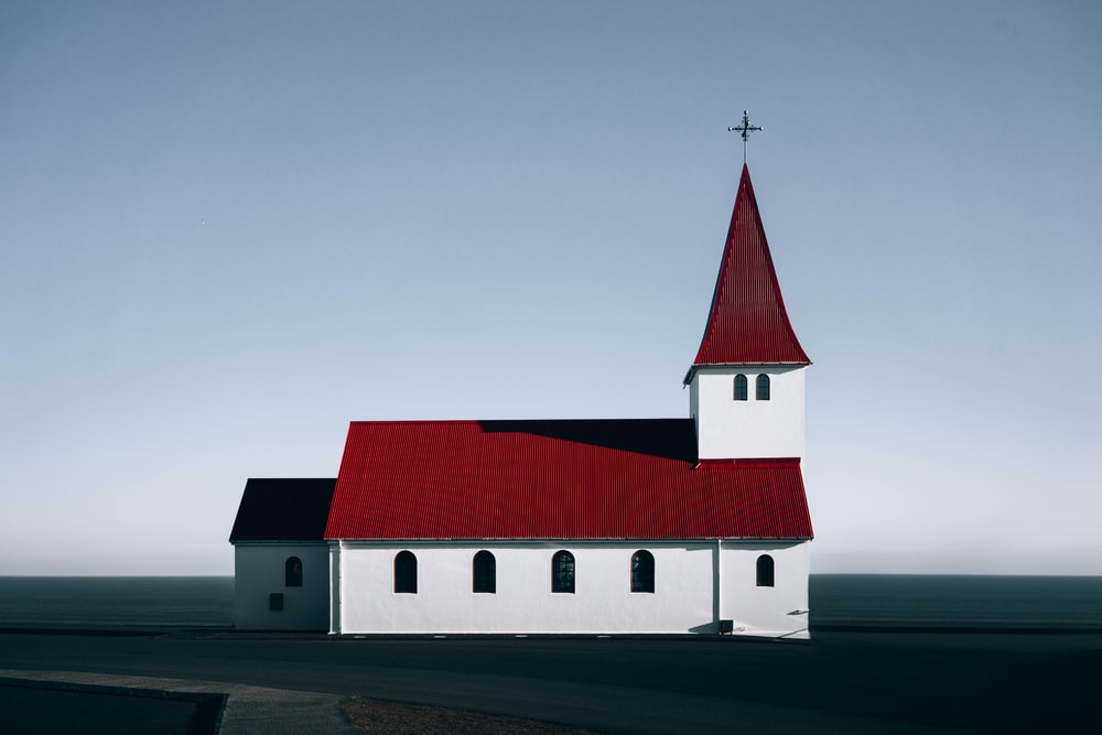 red roofed white concrete church illustration