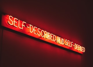 red self-described and self-defined LED sign