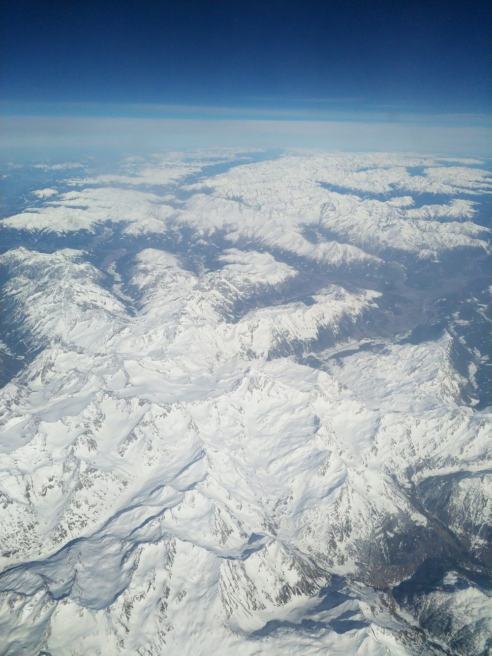 aerial view of snow covered mountain ranges