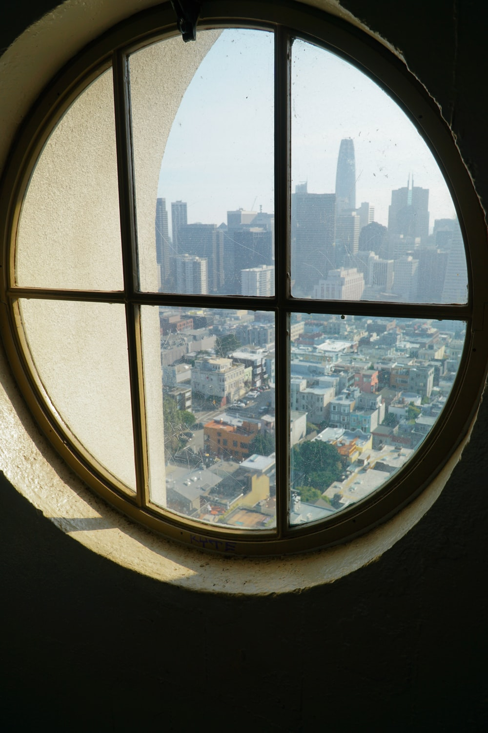 closed window viewing city with high-rise buildings