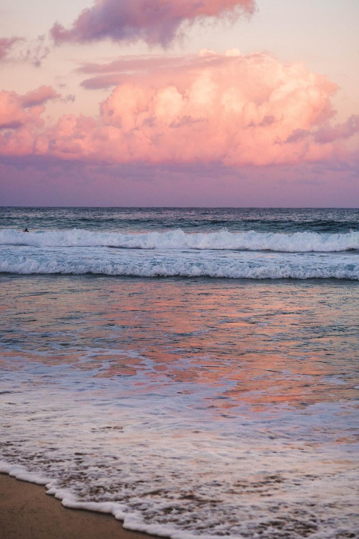 orange cloudy sky over beach at sunset