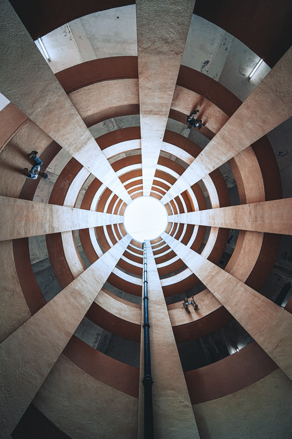 spiral view of people inside building