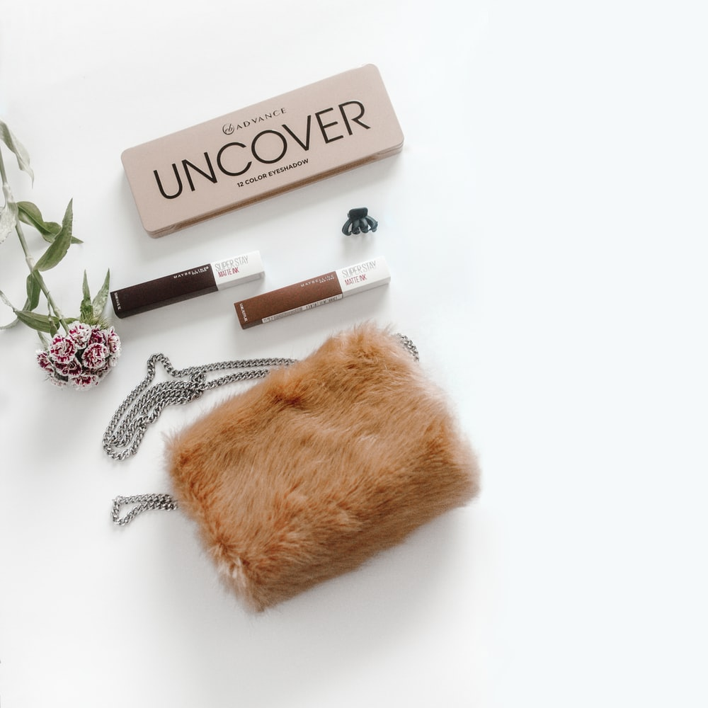 brown Uncover makeup with brown fur pouch