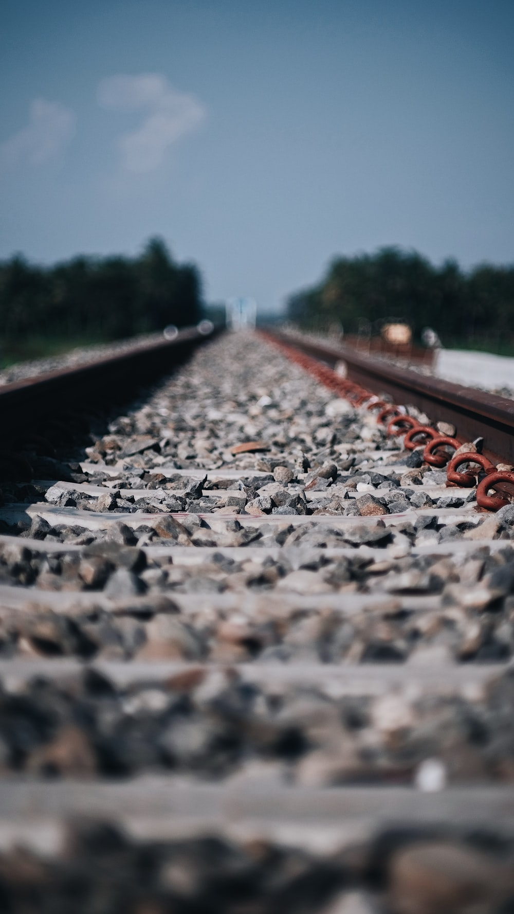 gray and brown train railway