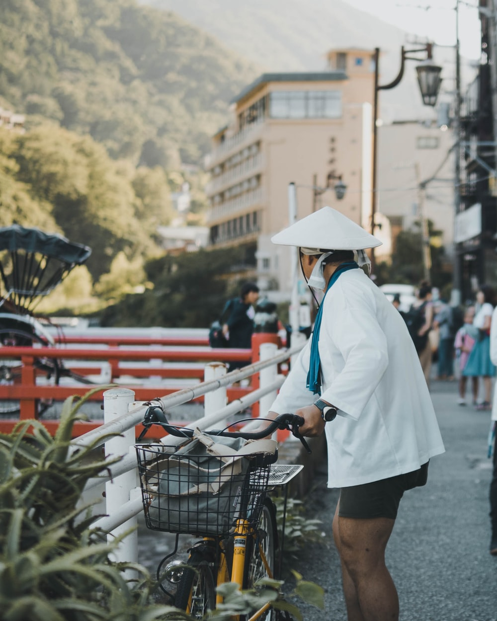 man holding bicycle during daytime