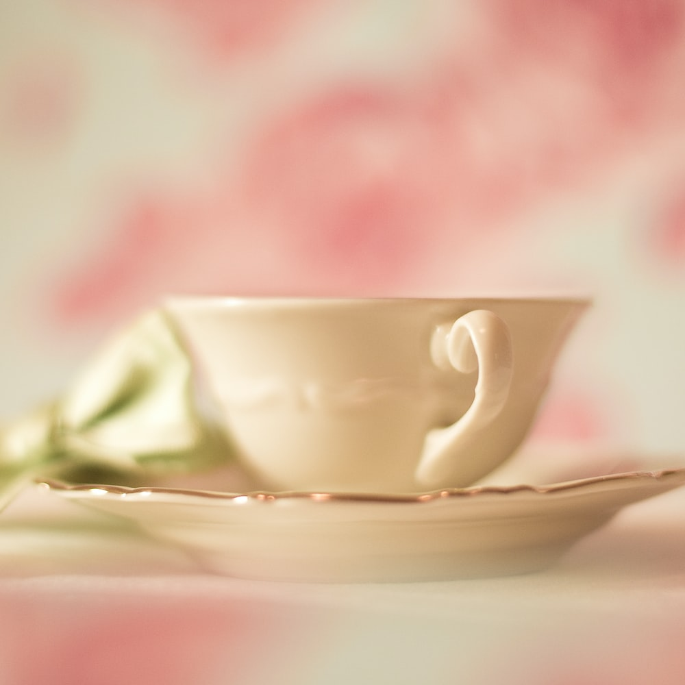 white ceramic cup and saucer set