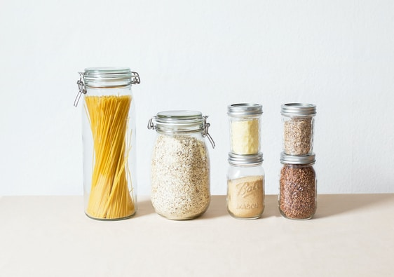 six assorted spice containers