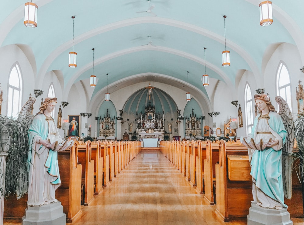 two angel statues placed on both aisle inside church