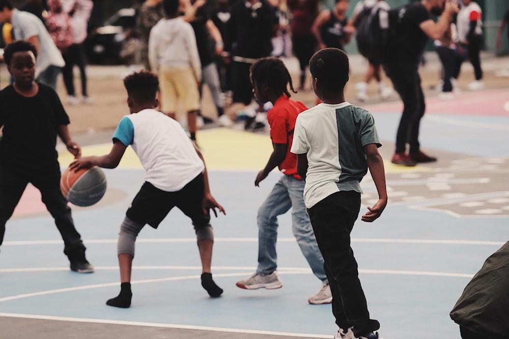 children playing street basketball