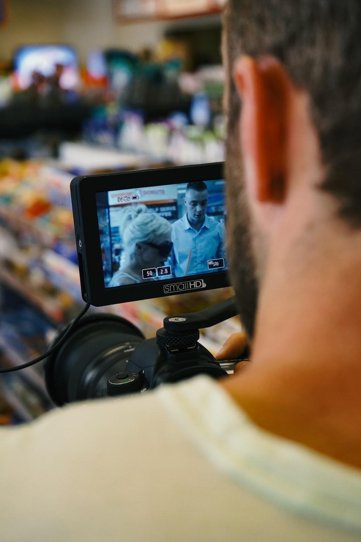 man holding video camera