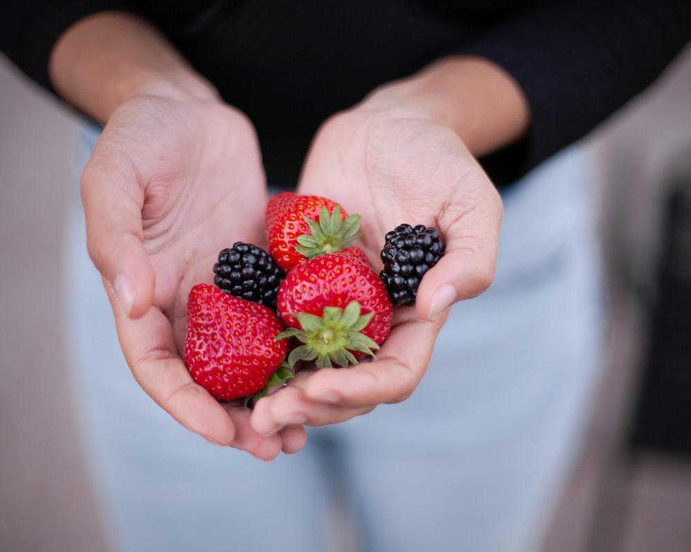 three strawberries and two blackberries