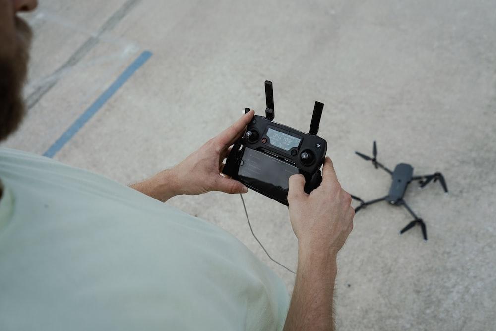 person holding drone remote control
