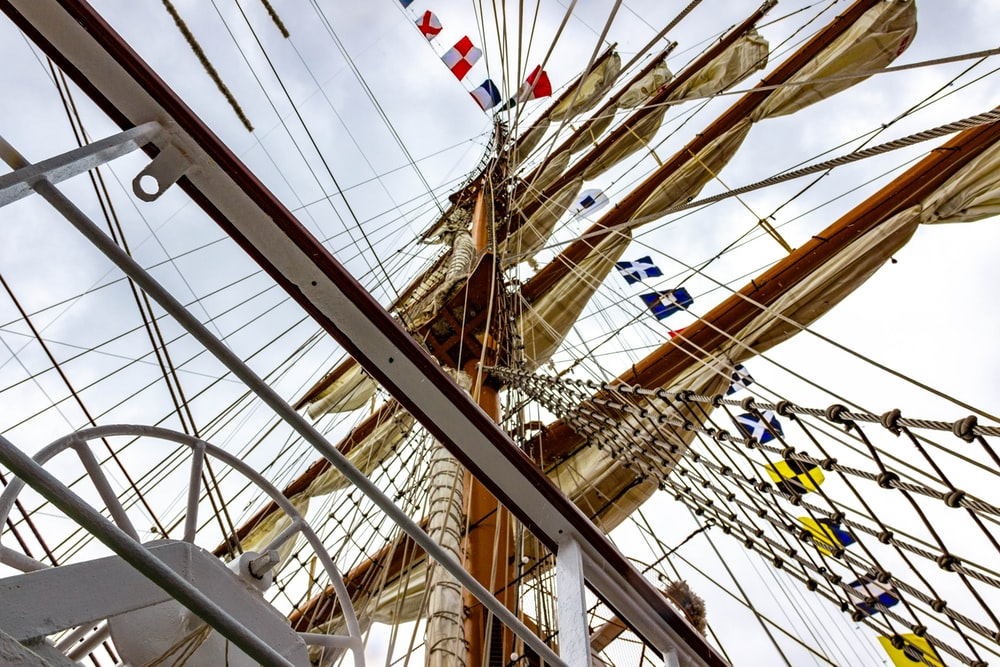low-angle photography of ship masts during daytime