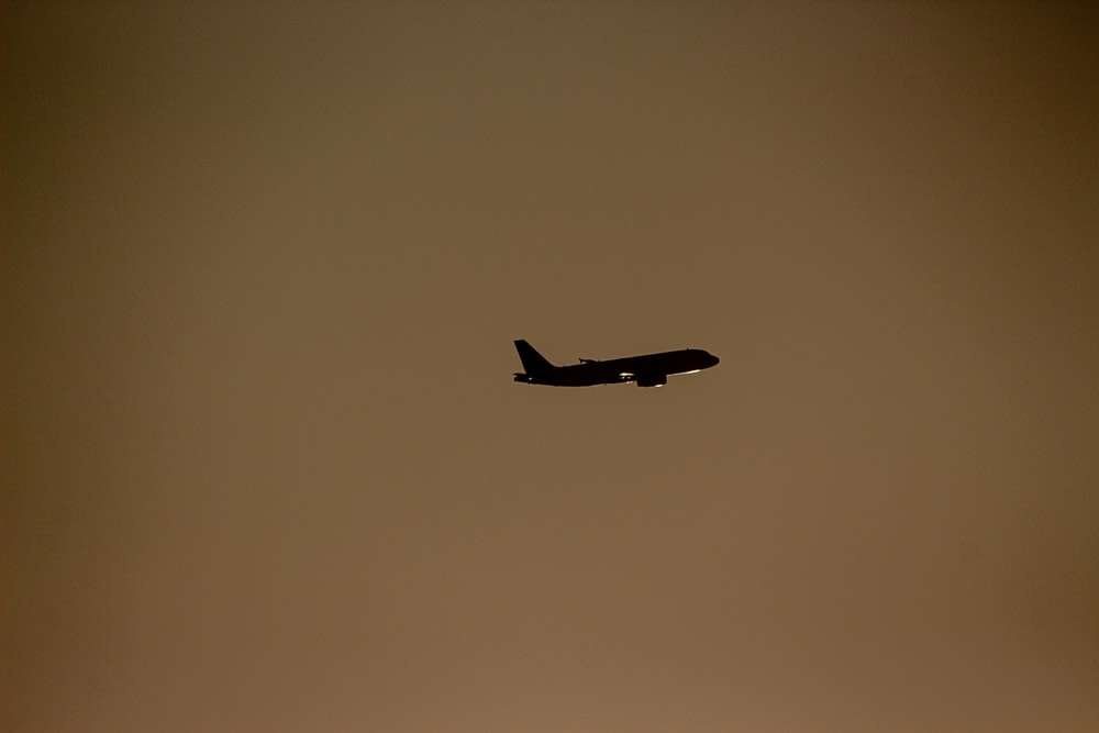 silhouette photography of air liner during flite