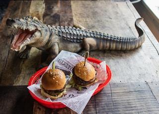 two sliders on plate beside crocodile statuette