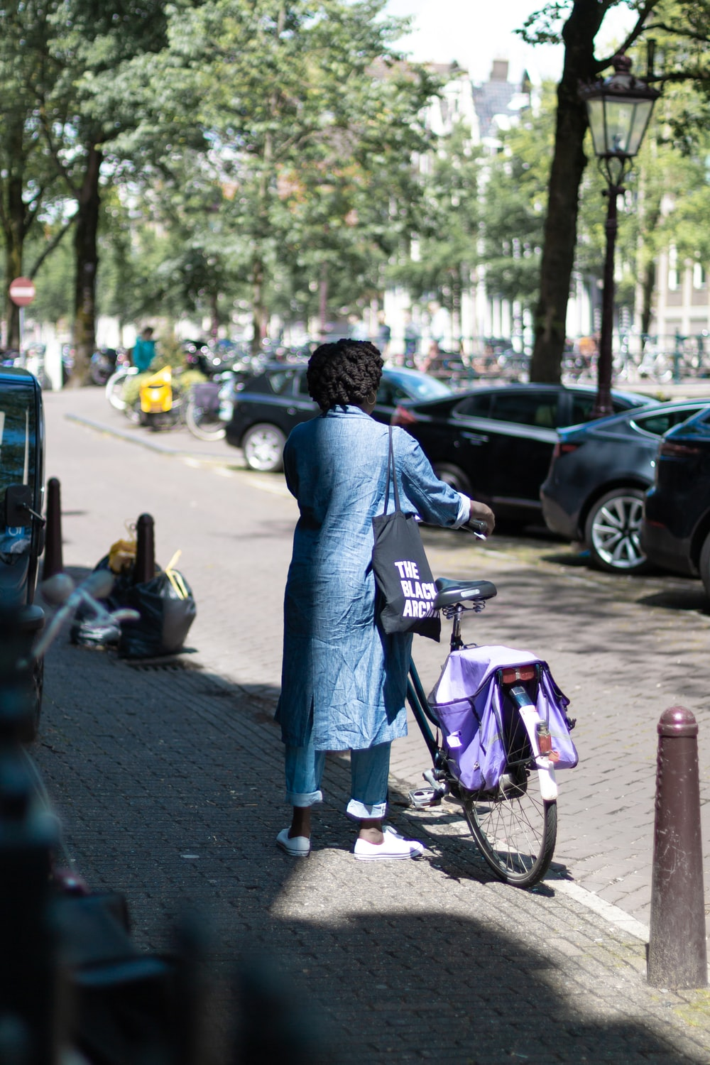 woman standing in front of bicycle during daytime