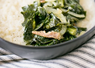 "Grits and Greens are a Southern staple. It may be sacrilege that I made these ""grits"" with cauliflower."