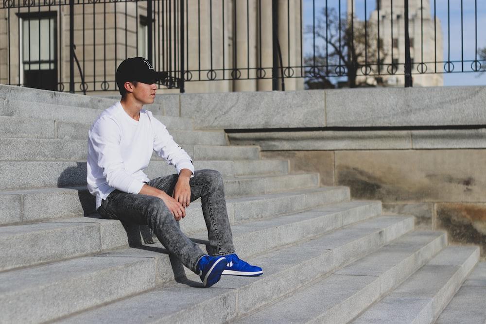 man sitting on stair