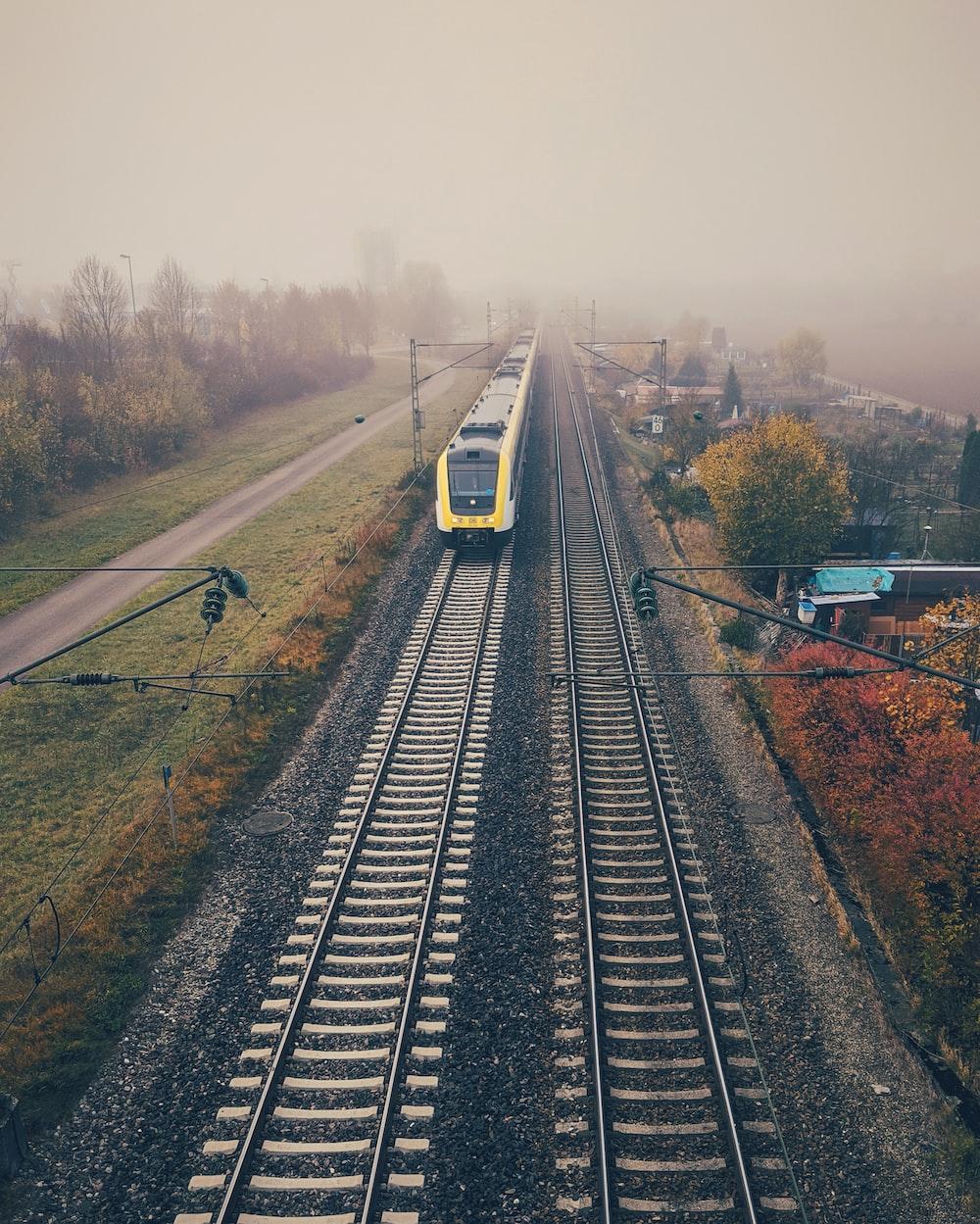 yellow train under grey sky