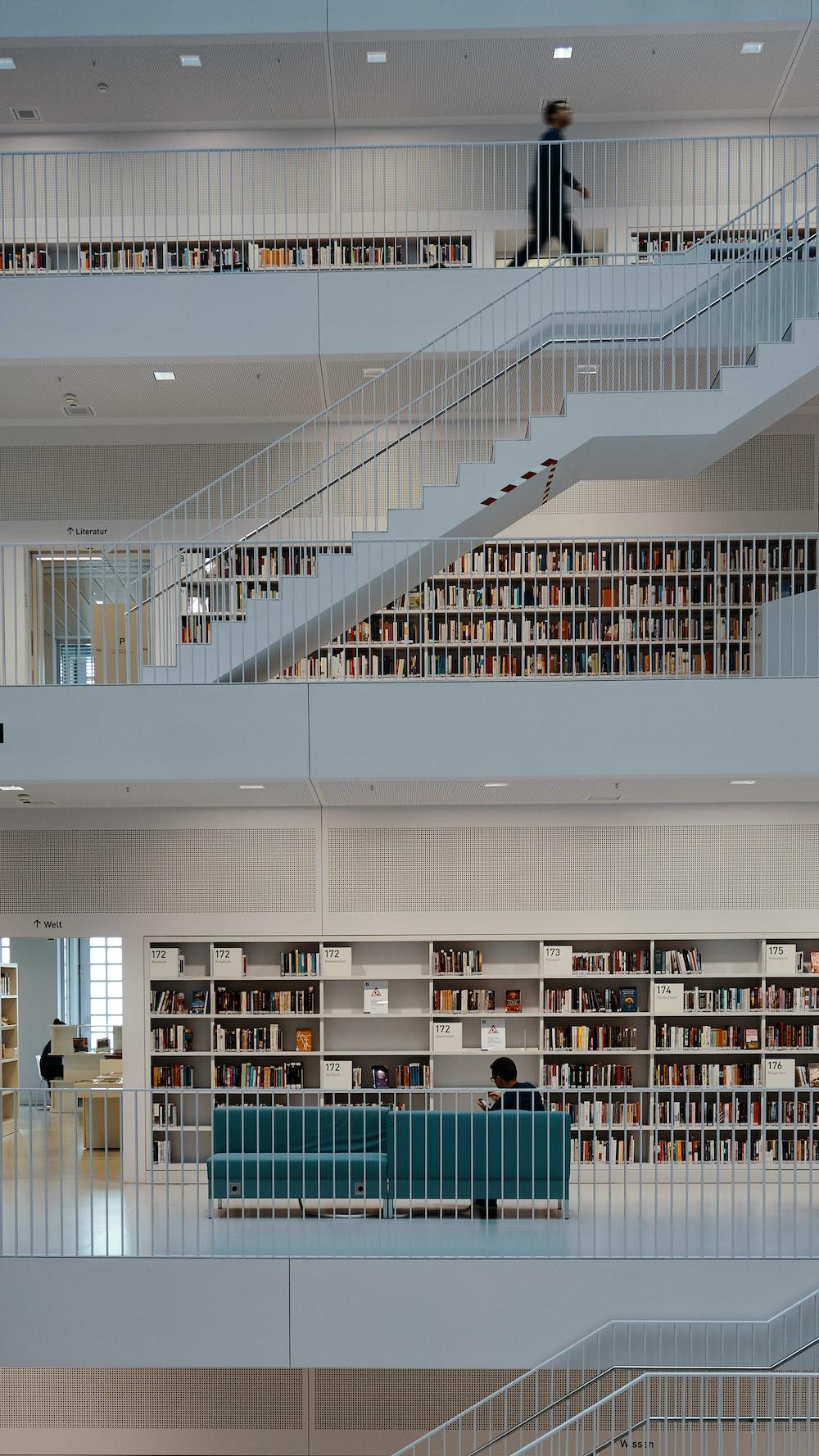 man walking on library