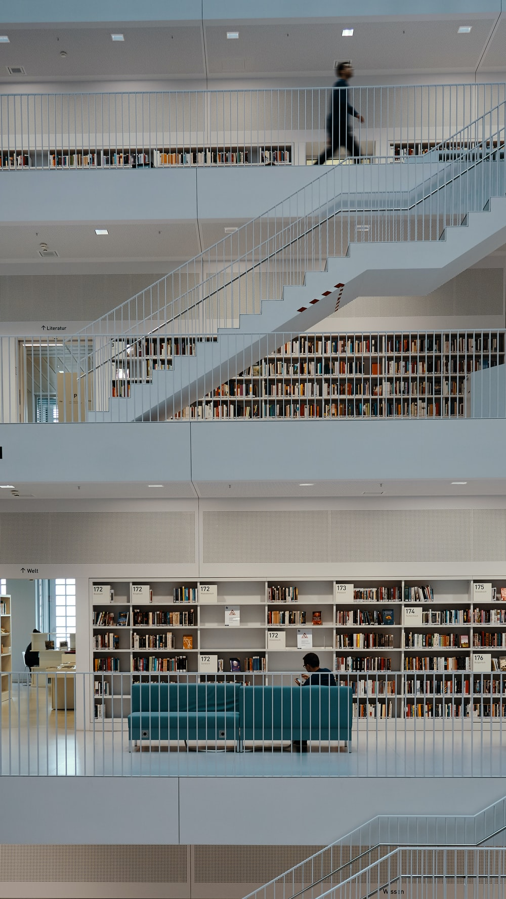 man walking on library