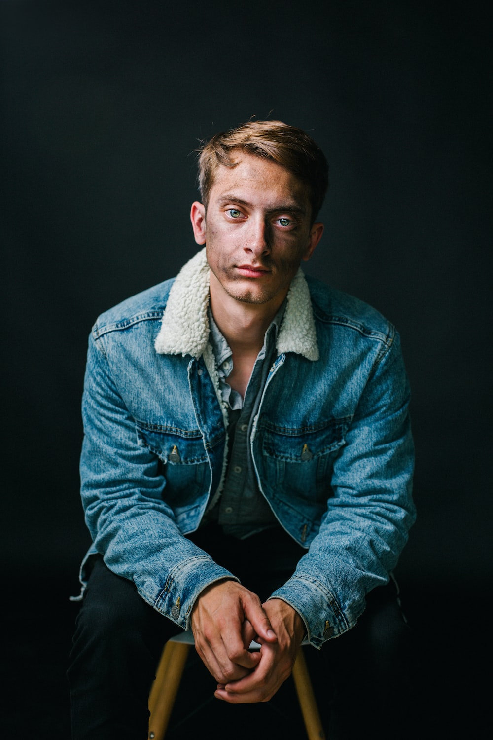 man wearing blue denim jacket