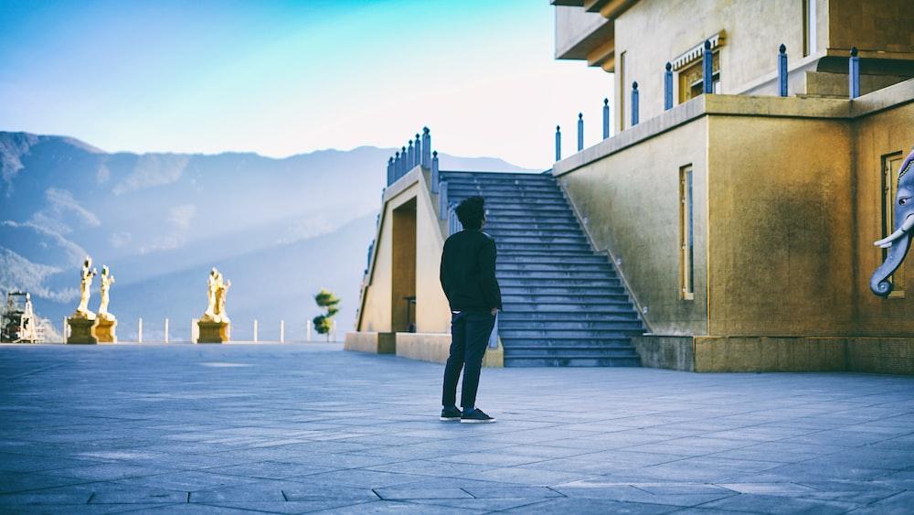 man standing near building