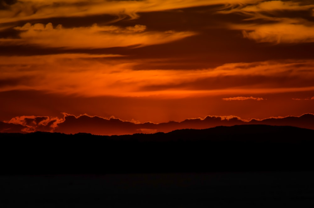 silhouette of mountains at dusk