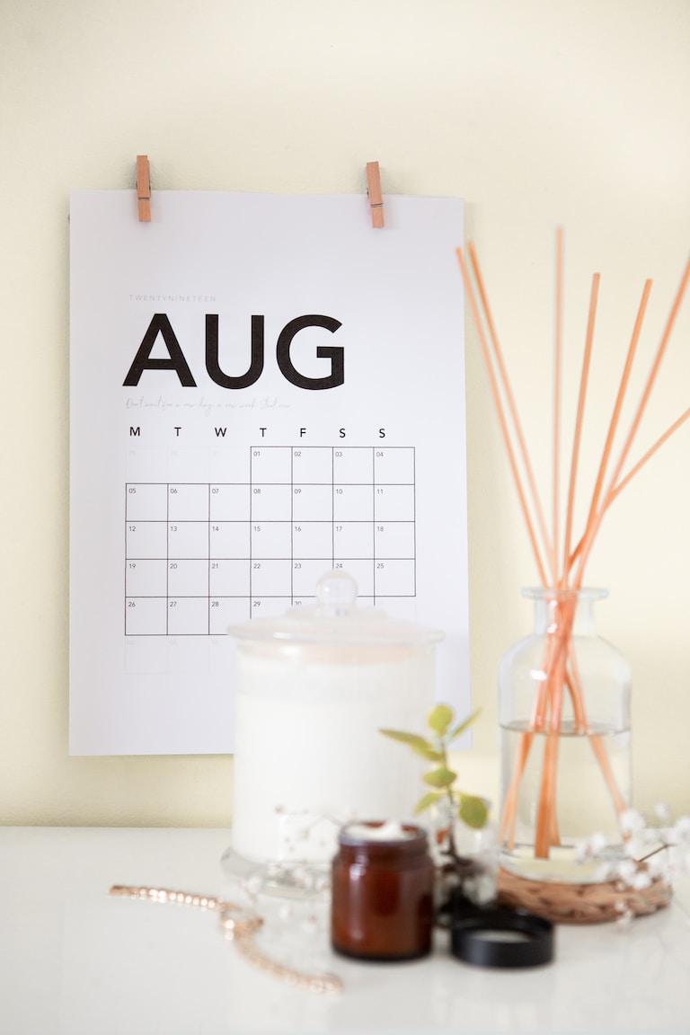 Aug calendar on wall