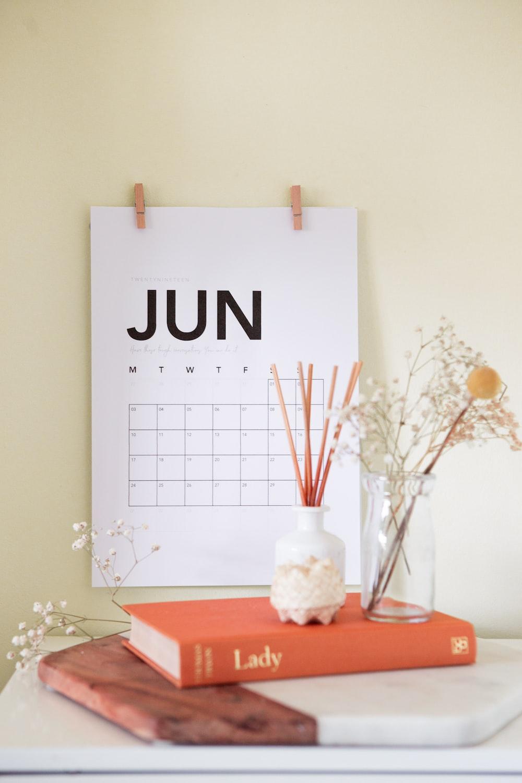 vase on book near calendar