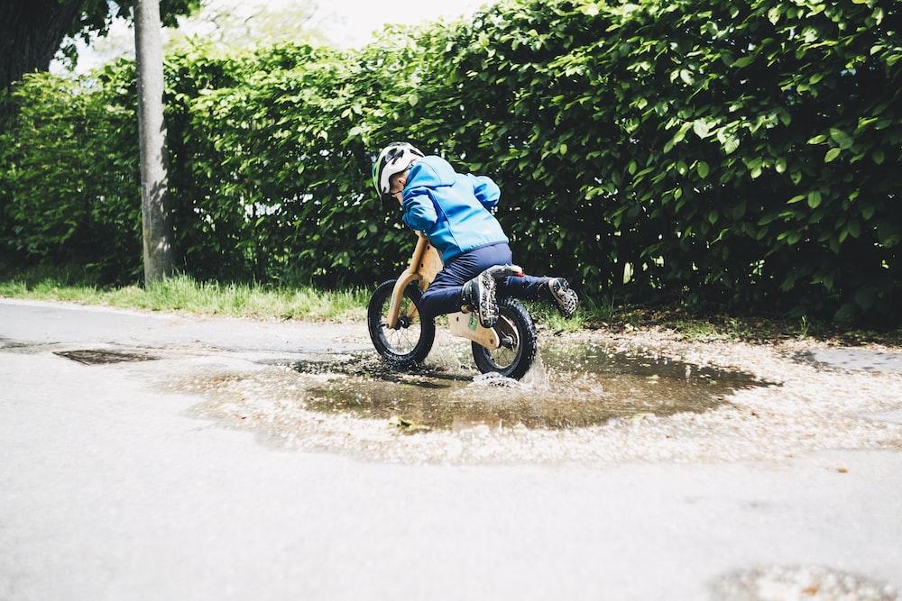 boy riding on bicycle during daytime
