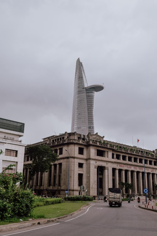 skyscraper behind concrete building