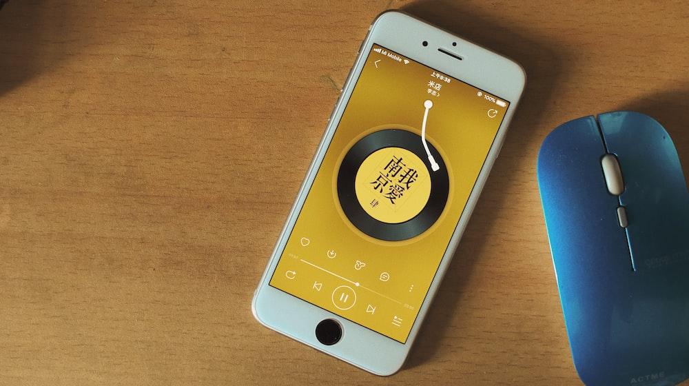 gold iPhone X near Apple Magic mouse