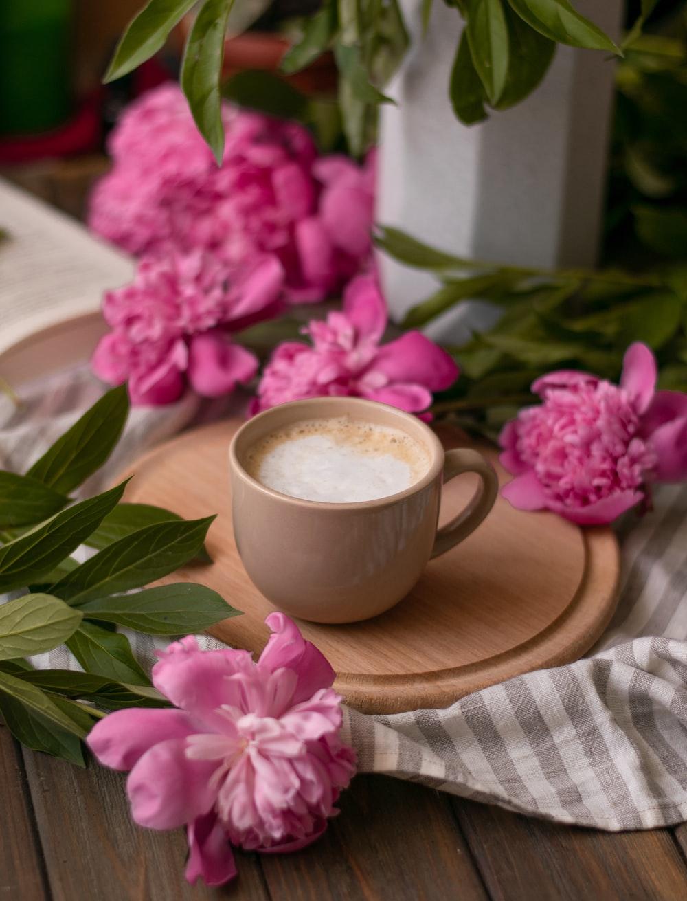 brown ceramic teacup with latte
