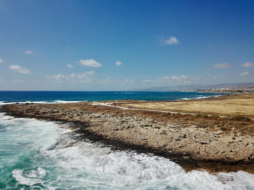 beach line under blue sky