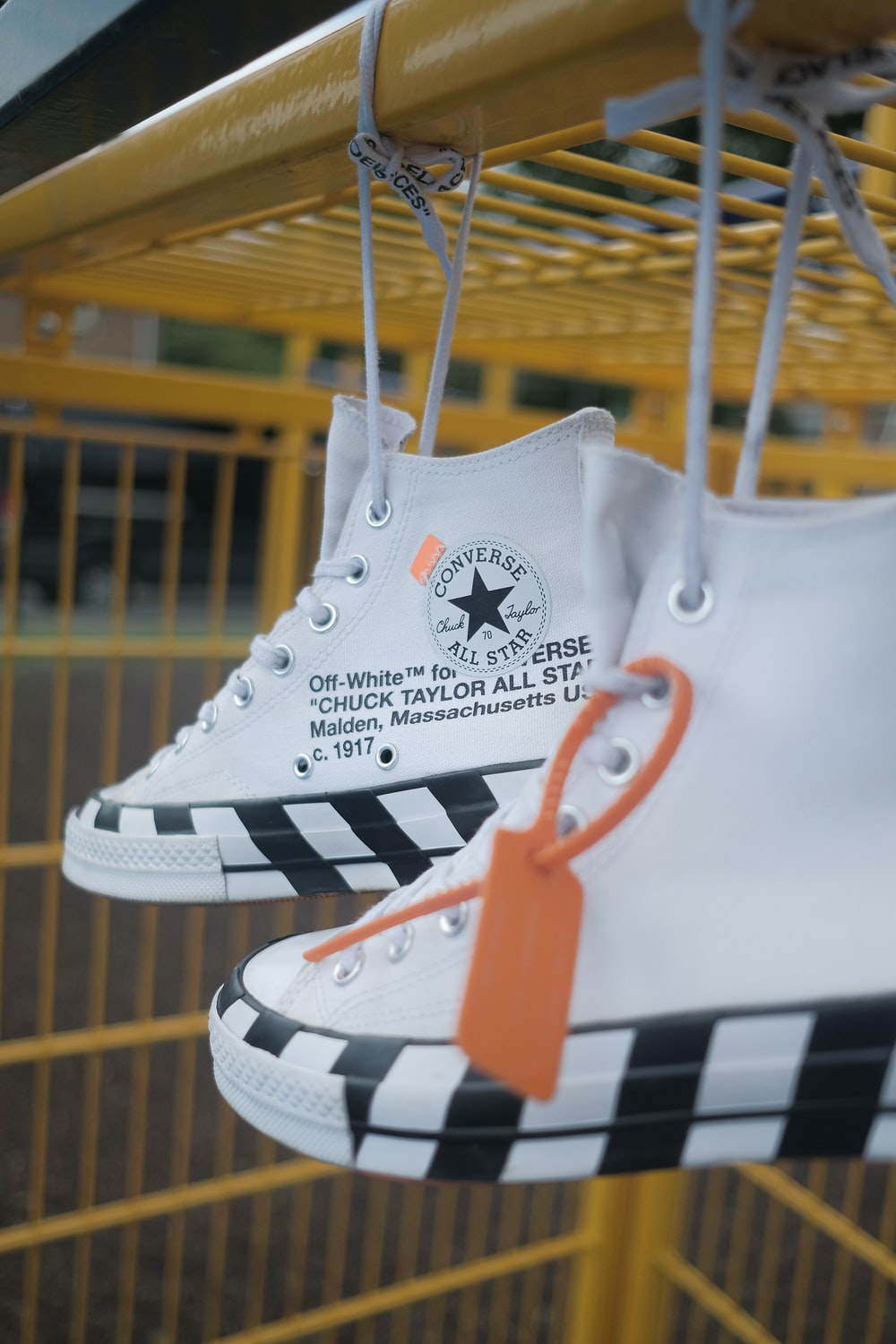 white-and-black Converse All-Star high-top sneakers