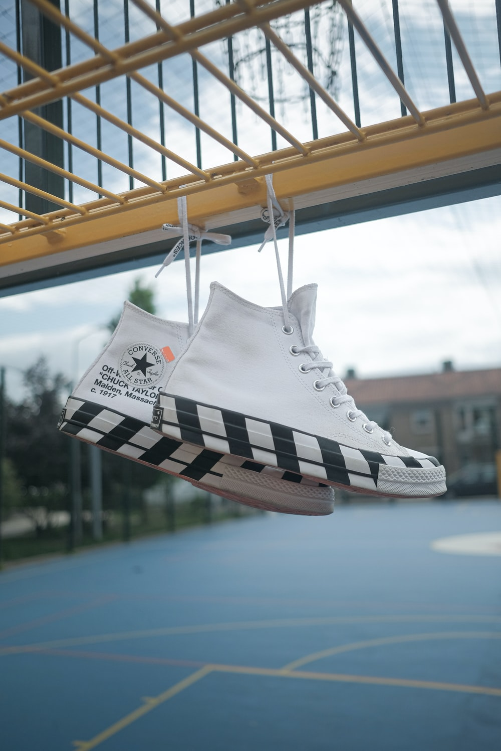 pair of white Converse All Star sneakers
